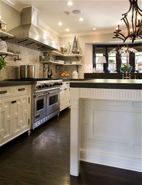 white kitchen cabinets dark wood floors black pagoda chandelier transitional kitchen brown