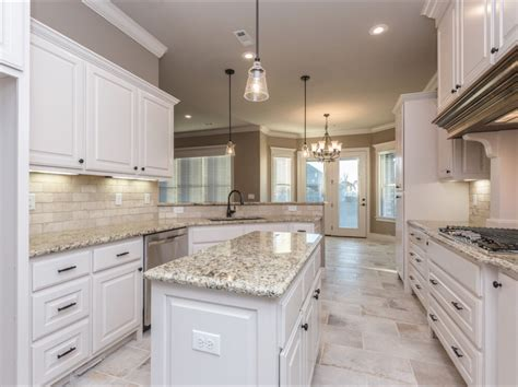 white kitchen cabinets tile floor spacious white kitchen with light travertine backsplash