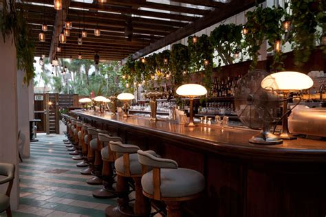 soho beach house cecconi s bar is lined with old fashioned stools and vintage ls soho beach house