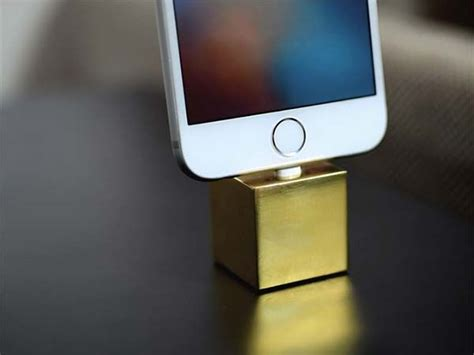 the q is a minimal iphone dock made from brass stainless steel or copper gadgetsin