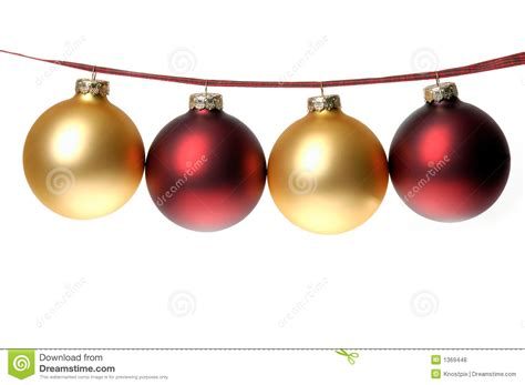 christmas photo of red and gold ornaments strung on plaid