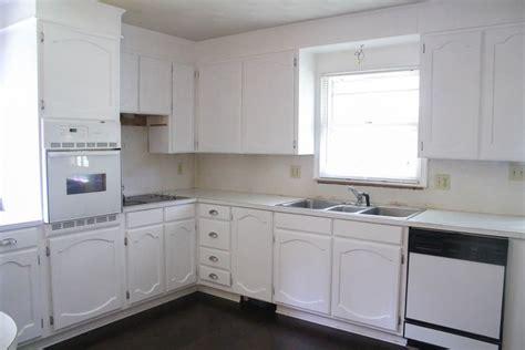 painting oak kitchen cabinets white painting oak cabinets white an amazing transformation