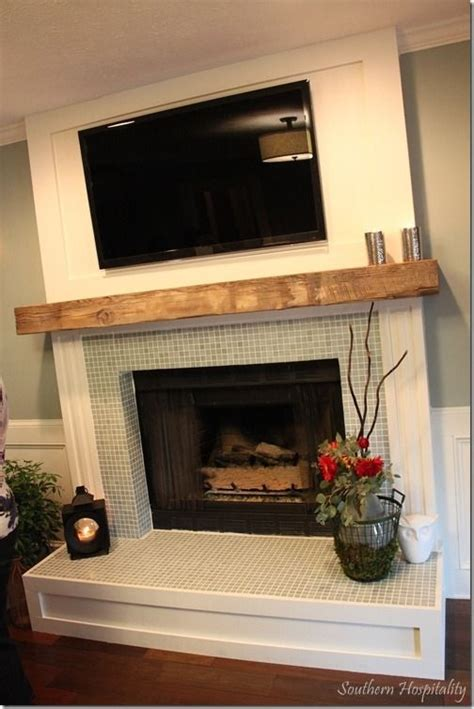 i the glass tile around fireplace and the wood casing