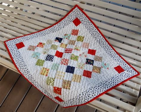 this pretty table topper is simply charming quilting digest