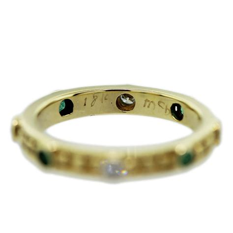 18kt yellow gold emerald bezel set ring raymond