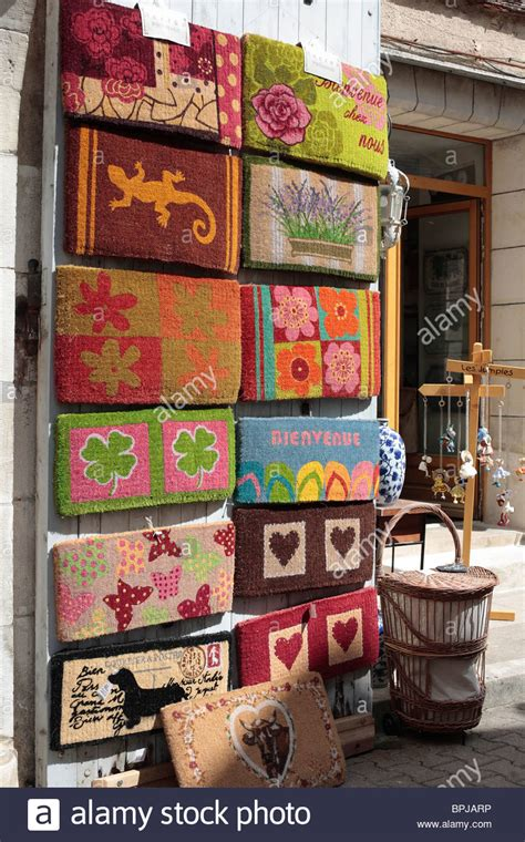 Doormat Shopping doormats on display outside a shop in the of vezelay stock photo royalty free