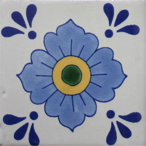 Traditional decorative mexican talavera tile in blue flower design