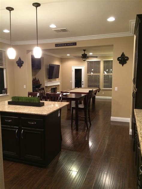 kitchen and pool room items remodeled from tile and carpet to laminate white tile counter