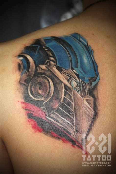 optimus prime tattoo abel gatbonton optimus prime favorite artist