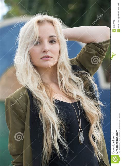 photos of ladies with blonde hair who have had a deep red weave young woman with blonde hair stock image image 31510801
