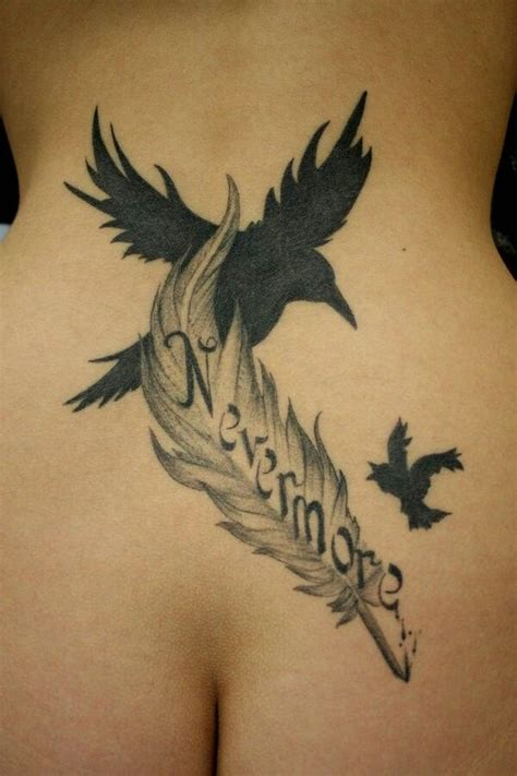 cross and bird tattoo black bird and feather lower back sleeve tattoos