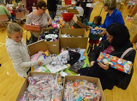 gurnee church packs shoe boxes with gifts for kids in need