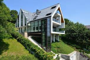 Houses Built On Slopes by A House On A Slope Connects To Its Surroundings Through A