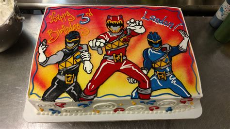 sheet power rangers cake features airbrush accents  hand illustrated rangers