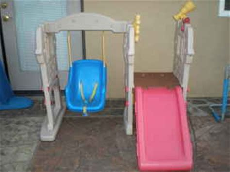 little tikes castle slide and swing mybundletoys little tikes castle swing n slide set