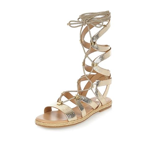gold metallic sandals river island metallic gold lace up gladiator sandals in