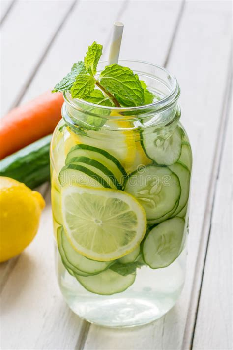 Lemon And Cucumber Detox Water Reviews by Infused Water With Lemon Cucumber And Mint Stock Image