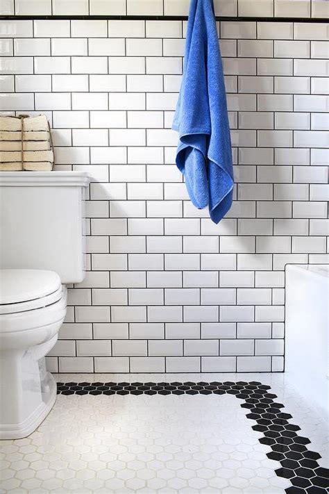black and white border tiles for bathroom bathroom with black and white hex tile floor transitional bathroom