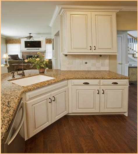 white kitchen cabinets with granite countertops picture of antique white kitchen cabinets with granite