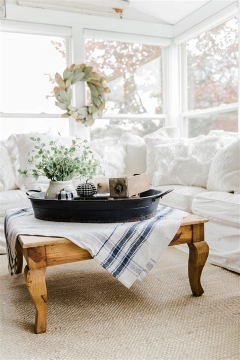 decorate with style 16 chic coffee table decor ideas a farmhouse style coffee table in the sunroom