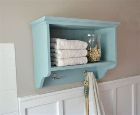 Bathroom Wall Storage by White Martina Bath Wall Storage Shelf With Hooks
