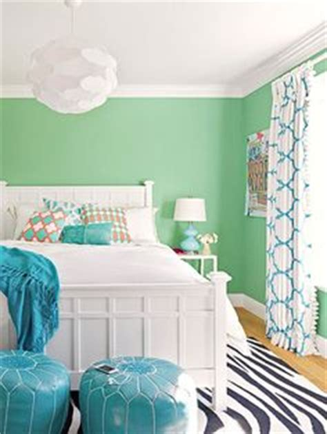mint green room we the mint green walls and pops of teal in this