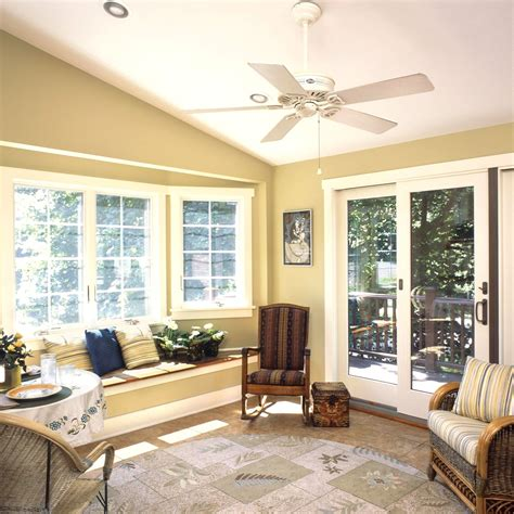 comfy sunroom interior nuance  gold wall paint color