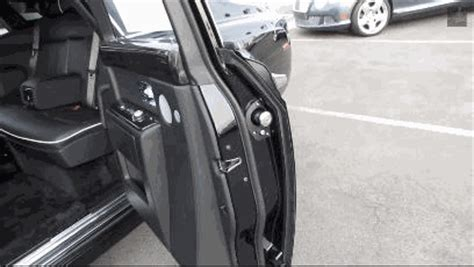 this rolls royce has an umbrella built into its door