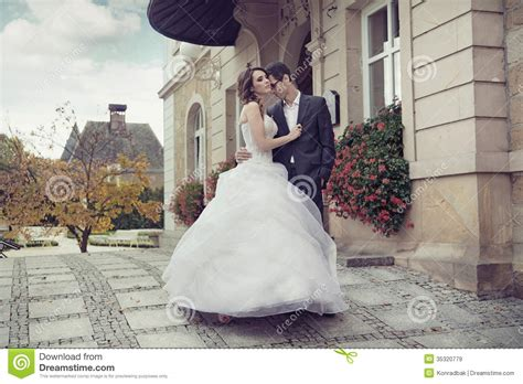 young wedding couple dancing outdoor royalty  stock