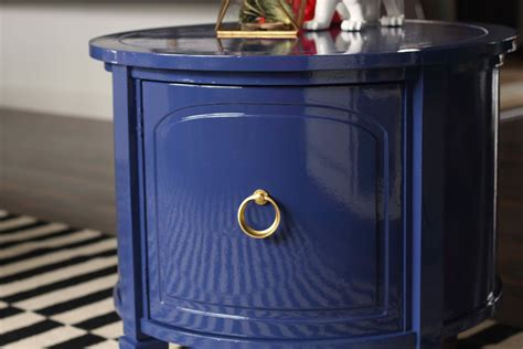 high gloss painted blue drum table the resplendent crow