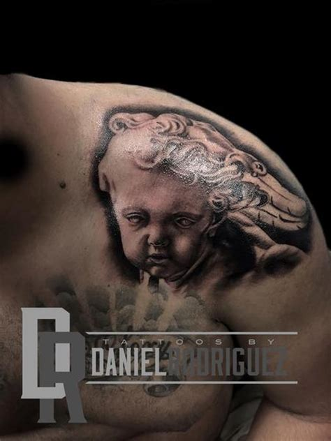 christian tattoo artist kansas city religious bernini cherub