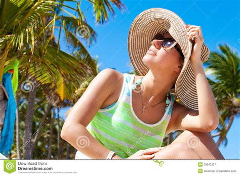 beautiful woman by the tree looking up stock photo image woman under palm tree at beach stock photo image 39243237