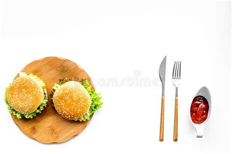 Fast Food Cutting Food fast food restaurant burger on wooden cutting board on