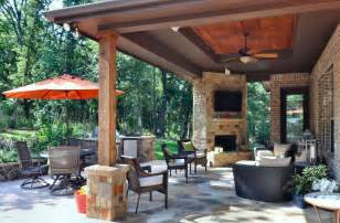 modern patio with custom stone outdoor fireplace by atkins design group zillow digs zillow