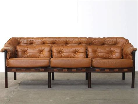 camel color sofa tufted leather camel colored three seat arne norell sofa at 1stdibs