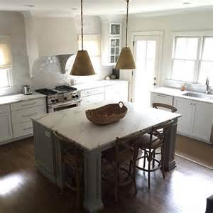 gray kitchen island with gold pendants transitional