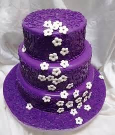 purple wedding cake with white flowers arabia weddings