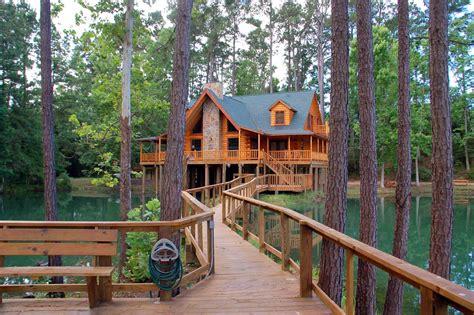 retreat  artesian lakes log cabin rentals   lake houston area cabin rentals