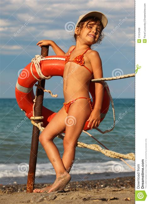 Bathing Suit Little Girl Beach | little girl in bathing suit standing on beach royalty free