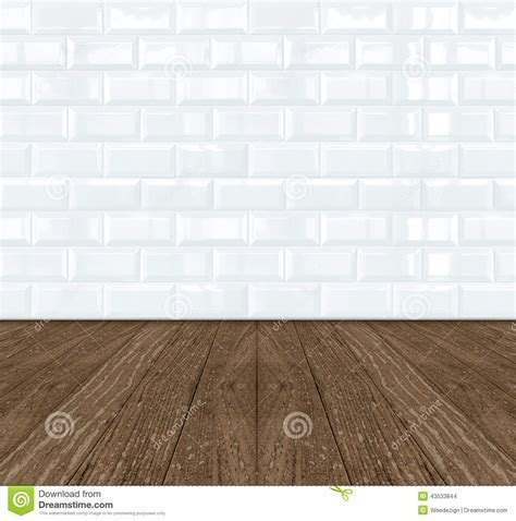 White Ceramic Brick Tile Wall And Wooden Floor Stock Photo