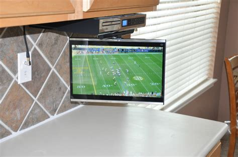 under the cabinet tv for the kitchen under cabinet kitchen tv buyers guide quality mobile