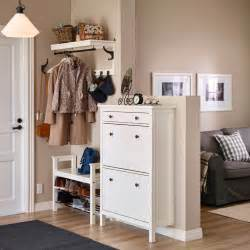 Ikea Small Spaces small hallway with a white shoe cabinet and a seating bench with