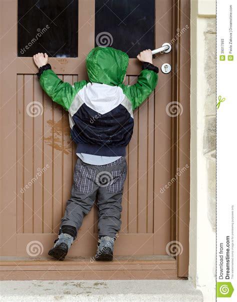 porta enfants child opening door stock image image of front