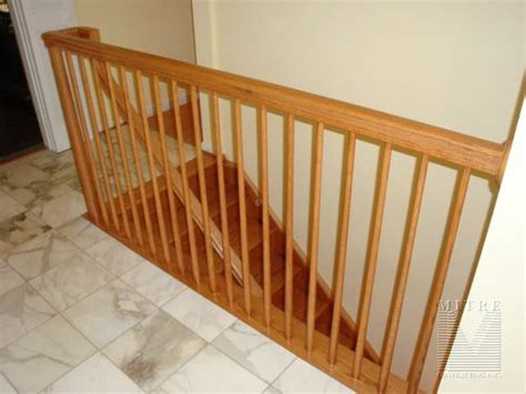 Oak Banisters by Stair Tread And Railing Renovation Mitre Contracting Inc
