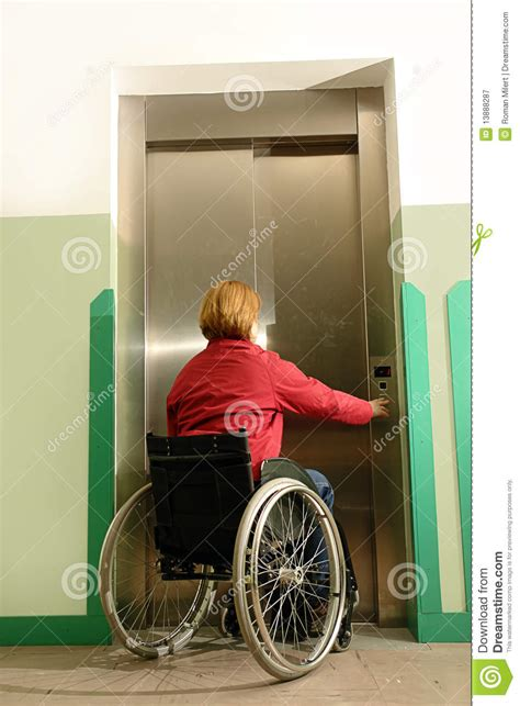 Home Plans With Elevators handicapped using elevator royalty free stock photography
