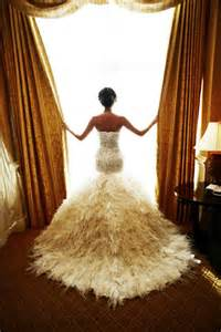 Feathered skirt adds such a luxurious texture to this fabulous gown