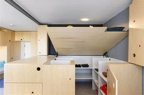 bed with mini closet underneath 30 sqm modern studio apartment full of space saving