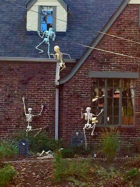 skeletons climbing house are these the best halloween yards in nashville