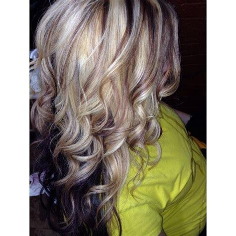 dark hair base with platinum highlights blonde and brown highlights with a dark base hair style