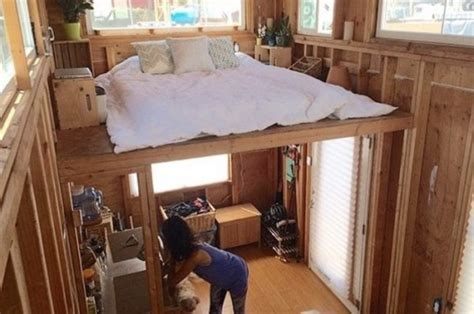 build a tiny house cheap man building a cheap diy 200 sq ft tiny home on wheels
